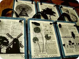 book page art on painted wooden boards