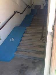 terrible ramp alongside stairs that no one in a wheelchair could actually use