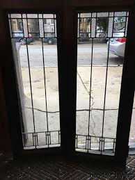 antique arts crafts leaded glass cabinet doors window circa 1910 each door measures 33 3 4 tall by 13 1 2 wide and the glass only is 30 by 10