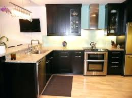 backsplash with white countertops and bath island by mocha tile white cabinets black what color walls