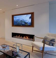 design tip recess a tv above a fireplace