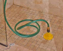 base with the correct length to reach below the drain or drain base and a sponge rubber gasket to prevent water from splashing back up the drain