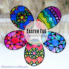make stained glass easter egg suncatchers with kids this craft comes with four free printable