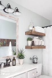 modern farmhouse bathroom with thick floating reclaimed wood shelves