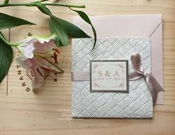 Wedding invitation card design is one of the most creative areas of print design today. Ivory White Wedding Invitation Designs Invitations By Tango Design