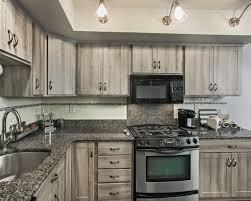 gray barnwood kitchen with 4 inch backsplash