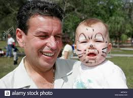 hispanic family activities. Miami Florida Kendall Family Festival Of The Arts Disabled Children Activities Hispanic Father Baby Painted Face Y