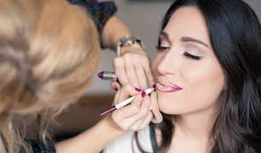makeup artist practising makeup