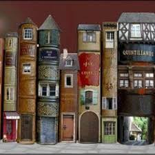 altered book spines as a city row of french houses businesses le village de livres by marie montard i would do this with beach houses