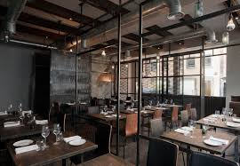 This is a restaurant, but it would look cool at home. industrial  environment restaurant
