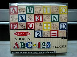 this is a wonderful set of 50 traditionally styled alphabet blocks with hand painted artwork featuring solid wood blocks with a colorful collection of