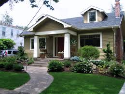 landscaping compliments the small porch. Really nice touches to draw you in.