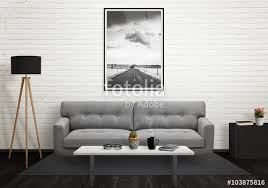 road picture in vertical art frame on wall sofa lamp plant glasses