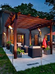 Inspiration for a mid-sized contemporary backyard concrete patio remodel in  Milwaukee with a fire