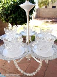 make a birdfeeder out of an old chandelier and thrifted tea cups tutorial at my3monsters