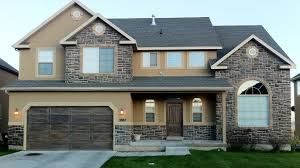 exterior house color combination. beige exterior house color combined with stone wall and concrete flooring combination i