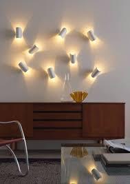 funky lighting. un satellite sospeso illumina delicatamente le pareti io la lampada fontanaarte firmata claesson koivisto rune funky lightingchurrunesoffice lighting