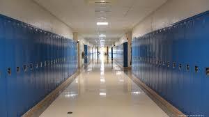 hallway at school. to a senior in highschool hallway at school t