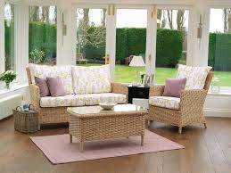 engaging laura ashley furniture replacement cushions in natural wicker rattan sofa set with armchair and glass top rectangle table on purple rug natural wood flooring decor sofa cushion
