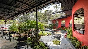 inside surat s lush new garden restaurant think of it