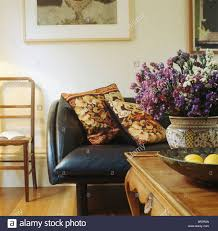 Tapestry Sofa Living Room Furniture Dried Flower Arrangement On Table In Living Room With Tapestry