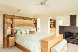 sweet contemporary bedroom built in cabinetry features bed headboard with shelves paired metal fireplace surround