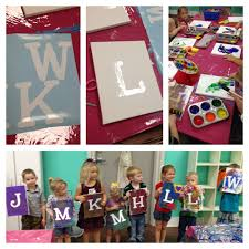 kid s art themed birthday party with initial paint canvas