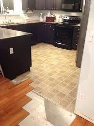 laying tile over linoleum laminate flooring putting ceramic tile floor can you glue on concrete install