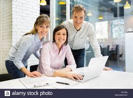 office meeting. Stock Photo Business Man Woman Computer Desk Office Meeting