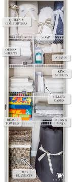 how to organize a small linen closet with spare bulky bedding quilts and sheets