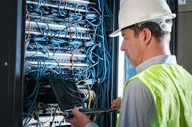 commercial central electrical solutions 24379335 electrician checking a fuse box