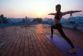 india mysore woman practising yoga on roof