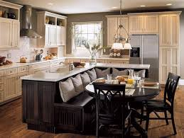 Kitchen Island/breakfast nook combo. A good idea to keep in my back pocket