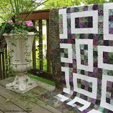 Hopscotch Batik Quilt #2 • Freemotion by the River & Batik Hopscotch 2 pattern and flowers on the deck Adamdwight.com