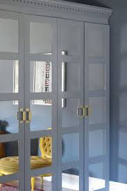 slate grey framed mirrored doors plus geometric brass handles for a contrasting and eye catchy