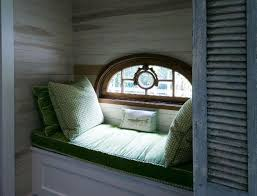 Small built-in window bench with cushions