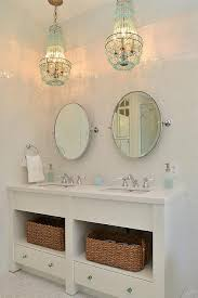 turquoise beaded chandelier over bathroom vanity