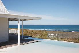 infinity pool beach house. Beach House And Infinity Pool Overlooking Ocean : Stock Photo Beach A
