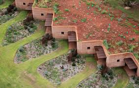 semi buried houses in australia rammed earth wall by luigi rosseli architects
