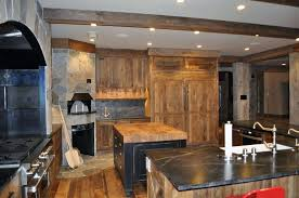 rustic kitchen with stone oven solid wood cabinets soapstone counters and two islands