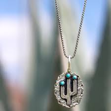 swooning over this cactus pendant by richard schmidt jewelry design sabi boutique today and add this piece to your collection