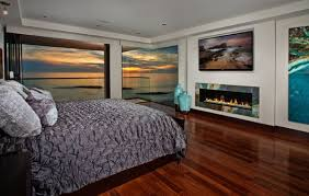... Colorful trim around the bedroom fireplace is only outdone by the  amazing view outside
