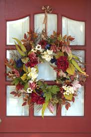Floral Wreath On A Red Door. Royalty free stock photos. All pictures ...