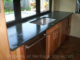 soapstone countertop on solid wood kitchen cabinet