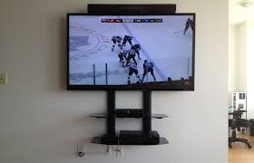 60 sharp tv installation with sony sound bar double component shelf wall mounted on drywall metal studs in condo