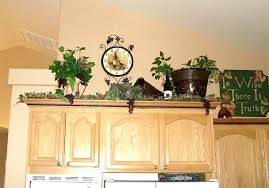 likeable decorating above kitchen cabinets ideas t2807924 decorating top of kitchen cabinet ideas