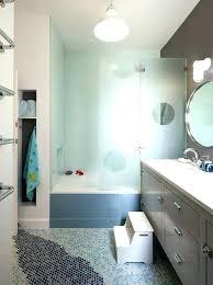blue penny tile floor penny tile shower tile floor tile design footstool frosted glass grey cabinets