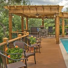 this wooden designed and built by archadeck of austin this l shaped wood pergola provides shade
