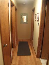 paint colors for hallwaysAny ideas to jazz up this dark narrow hallway with lots of doors