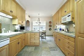 light wood cabinets long kitchen highlighted by natural light wood cabinets and drawers along with matching